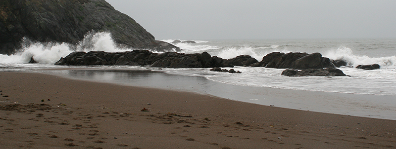 Waves crashing against the rocks on the beach at Fogarty Creek State Recreation Area, Oregon Coast.